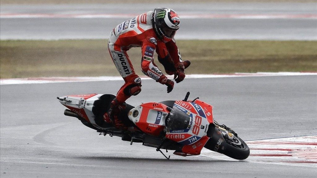 Moto GP rider Jorge Lorenzo of Spain falls off his bike during the San Marino Motorcycle Grand Prix at the Misano circuit in Misano Adriatico Italy Sunday Sept 10 2017 AP Photo Antonio Calanni